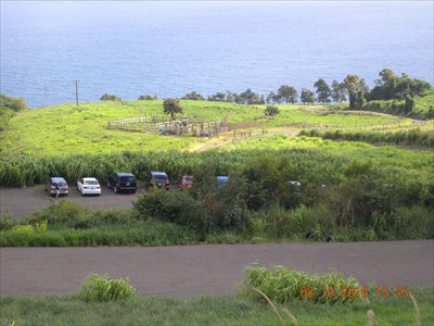 View of the parking lot below and the ocean
