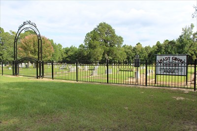 The cemetery and Texas Historical Marker referenced on the sign.