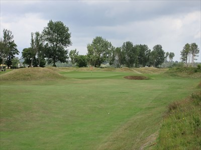 The short par four fourteenth hole must negotiate small mounds near the green.