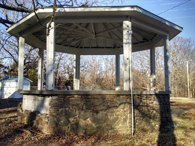 Gazebo at the Seligman City Park, by MountainWoods.  More damage at the back of the gazebo.  Although the coordinates took me, and others, to the front of the gazebo, I believe that this damage was also caused by thoughtless geocache hunters who, from the cache description, thought that it might be among the rock on this side of the gazebo.  They were simply looking for any rock that looked loose, had a crack, or could somehow come out, no doubt.