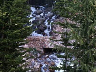 Bridge with Hoop Creek Waterfall flowing under.