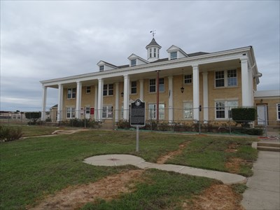 The fence is a current (2015) barrier while the school undergoes repairs after a spring tornado did extensive damage here.  Note the new windows and damaged weather vane.