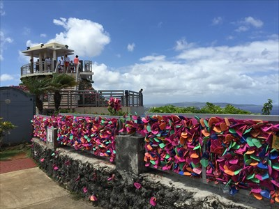 People can buy heart shaped padlocks and heart message tags and attach them to the fence and the rock at the point