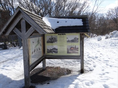 two panels of the main sign with trail in background
