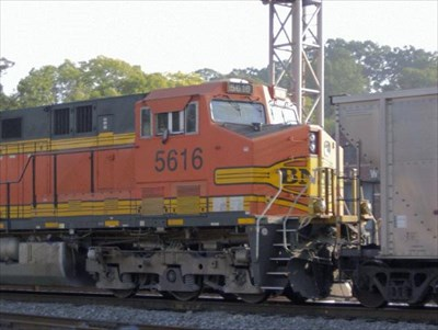 Here BNSF (Burlington Northern Santa Fe) 5616 is bringing up the rear of a southbound coal train.