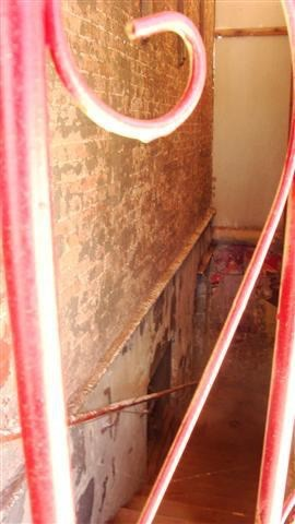 The only entrance was off of the side street down a flight of creepy steps ;-)    Now closed off with a red painted gate.