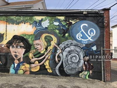 Right third of the mural -- with man-snail and moody person