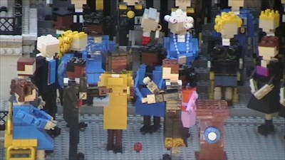 Close-up of Lego Barack Obama being sworn as President with Michelle Obama holding a Bible.