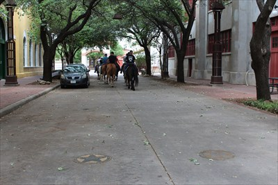Joseph Glidden at left, Nat Love at right, and the cowboys and cowgirls are heading up towards Billy Bob