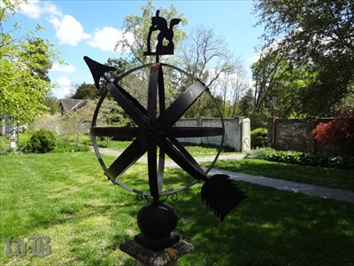 The armillary sphere with the arrow parallel to the earth`s axis.