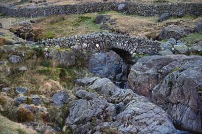 The bridge was still in the early morning shaddow cast by Glaramara.