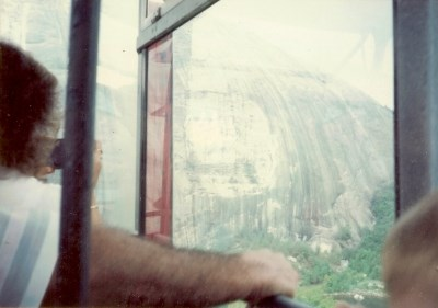 View of Stone Mountain carvings through the aerial lift window, by MountainWoods