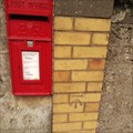 Image for Benchmark next to Red post box