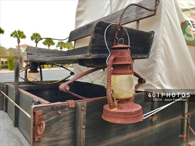 Detail: rusted lantern hanging from the driver's bench