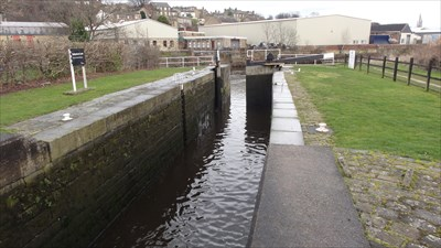 This end of the lock opens onto the main course of the River Calder. This is the end of Battye Cut.