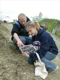 Two of my best students trying to identify a brachiopod they found.