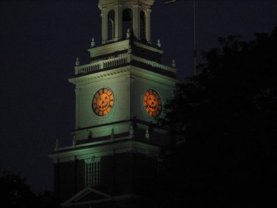 All the faces of the clock tower are decorated for Halloween.