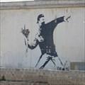 Image for Banksy graffiti: Man throwing flowers