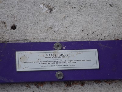 The 'Happy Hoops' plaque on the base.