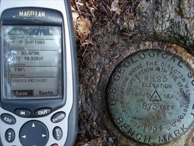 Benchmark w/ GPS rec'r showing location.
