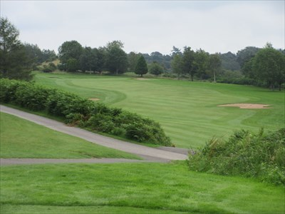View from the tee, playing down the hill and then back up to the green.