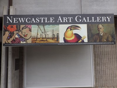 The sign at the entrance to the Gallery. Very near the Nest/Egg sculpture that towers above the visitors.