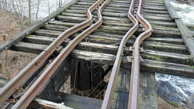 Buckled rails, charred beams, dangerous to walk on