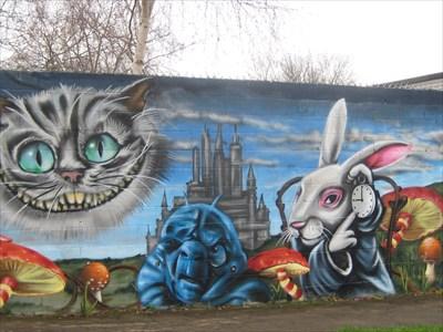 Alice in wonderland themed community center tinkers for Alice in wonderland mural