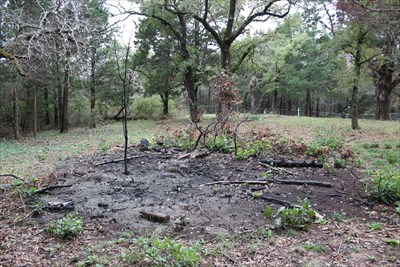 That must have been one heck of a burn pile.  Looks like there was another large one in the southwestern corner of the cemetery.