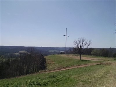 Cross at River of Faith Church, by MountainWoods.  Approaching the cross on the ridge, with the church behind us.