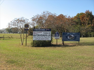 The sign is located on the east side of town.