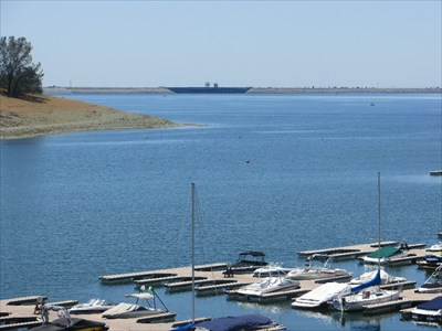 View of Folsom Lake with Folsom Dam in the background.