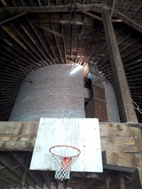 A good view of several things: the roof framing, the center brick silo, and the neat ladder on the outside of the silo. Also the basketball hoop (not original, I don't think).