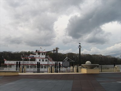 Sign showing record flood stage above the riverboat.