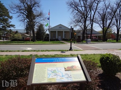 A CWDT marker stands across the street from the Spotsylvania Courthouse. Severely damaged during the Civil War, it underwent extensive renovation.