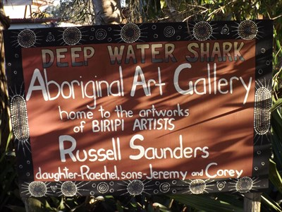 Another sign, closer to the house and gallery.