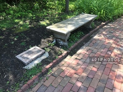 The dedication plaque to the left of the bench reads: <br><br>