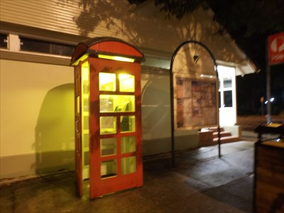 Street view, at night; with the Red Telephone box