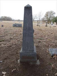 J.R. Swayze, referenced on the historical marker as the first burial in the cemetery.