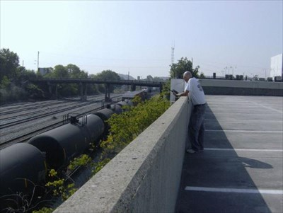 This view is from the top of the parking deck. Notice how close the tanker cars are. This was a northbound CSX.