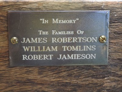 "Close up of the plaque for the Dedicated Bench, ""In Memory"" of families of: James Robertson, William Tomlins, and Robert Jamieson.