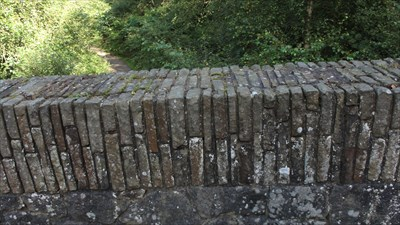 This close up shows the arrangement of smaller stone that look like bricks from the distance.