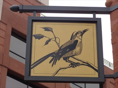 Sign for The Bird Cafe, established 2013, the current resident here.