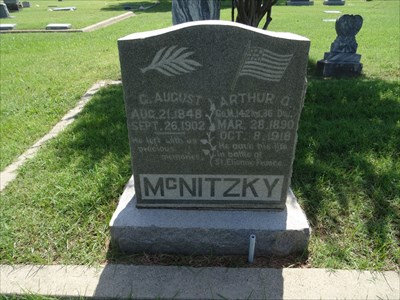 Private McNitzky shares a headstone with his father.