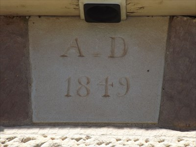 A Dated stone above the plaque on the cottage.