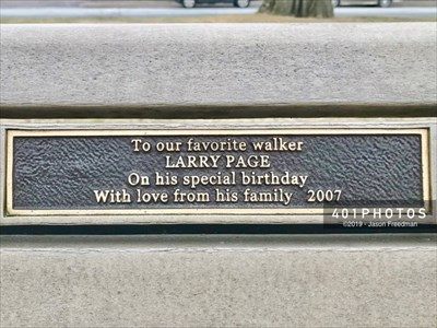The brass dedication plaque reads: 
