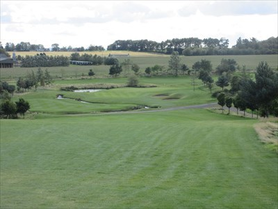 The view from the tee on the short par four 7th hole, with the Buddon Burn snaking around in front of the green.