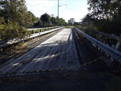 The local pedestrians still use this orphaned bridge, despite fallen yellow tape across it. 1510, Sunday, 30 April, 2017