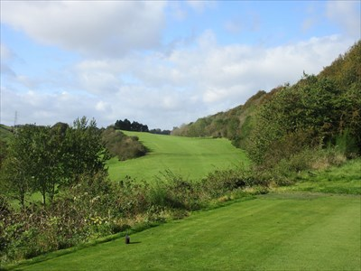 The view from the elevated tee on the long fifth hole. The green lies up the hill in front of the trees.