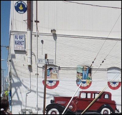 East side of building showing Masonic logo and mural.